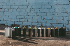 cans with colorful spray paint standing in row royalty free stock photography
