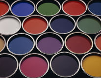 Cans of coloured paint. Multiple cans of coloured paint tins royalty free stock images