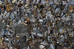 Cans compressed. A recycling bale of tin cans royalty free stock image