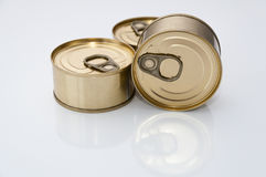 Cans of food. Three tins of canned food on a white background Stock Image