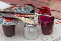 Cans of Gouache Paint with Paintbrush royalty free stock photos