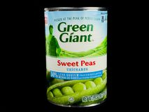 Cans of Green Giant Sweet Peas on Black Background. A can of Green Giant Sweet Peas on a black background Royalty Free Stock Images