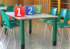 Cans with large numbers in kindergarten Stock Image