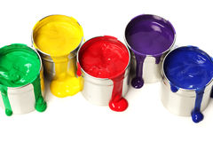 Cans of paint. Spilling on white royalty free stock image