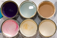 Cans of paint. Open cans of paint prepared for paint work Stock Image