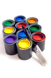 Cans of Paint. Colorful cans of paint on a white background forming a colorful background with space for copy etc stock photography