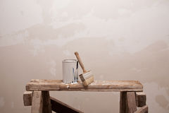 Cans of paint and brush on the building stairs Stock Photography