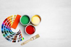 Cans with paint, brush and color palette royalty free stock photos