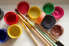 Cans of paint and a brush stock photography