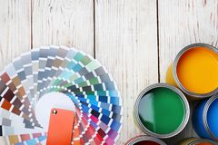 Cans with paint and color palette on wooden background. Top view stock photos