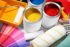 Cans of paint and decorator tools. On wooden floor stock photos