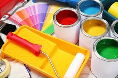 Cans of paint and decorator tools. On wooden floor royalty free stock images