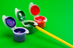 Cans of paint with paintbrush Stock Image