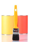 Cans of paint with paintbrushes  close-up Stock Photos