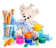 Cans of paint and teddy bear. Isolated royalty free stock photo
