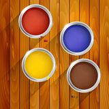 Cans of paint on a wooden background Stock Images