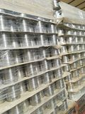 Cans palletized. In a pallet in a warehouse logistics Royalty Free Stock Photography