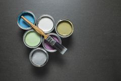 Cans of pastel coloured paint. royalty free stock image
