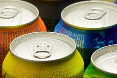 Cans of soft drink. Cooling frozen and with water drops royalty free stock photos