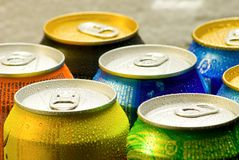 Cans of soft drink. Cooling frozen and with water drops royalty free stock photography