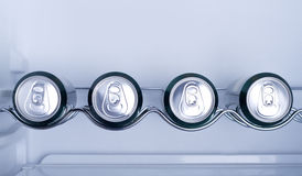 Cans of soft drink in a Refrigerator Stock Image