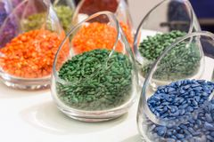 Multicolored etched sunflower seeds in glass jars. Cans with sunflower seeds of green, blue and other colors Stock Images
