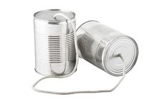 Cans telephone connected by string. Closeup of tin cans telephone connected by string on white background, business communication concept Stock Photos