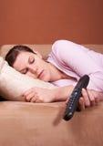 Cansado na frente da tevê Imagem de Stock Royalty Free