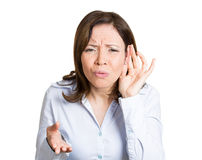 Cant hear. Closeup portrait unhappy hard of hearing woman placing hand on ear asking someone to speak up, listening to bad news, isolated white background royalty free stock photo