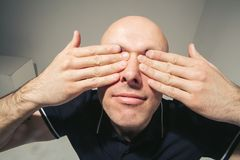 Cant see Man with closed eyes by hands Royalty Free Stock Photo