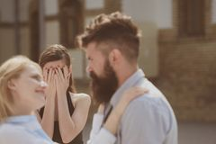 Cant see them together. Bearded man cheating his woman with another girlfriend. Unhappy woman feeling jealous. Romantic stock photo