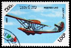 Cant Z.501 flying boat, International Stamp Exhibition Italia `85 serie, circa 1985. MOSCOW, RUSSIA - FEBRUARY 10, 2019: A stamp printed in Lao People`s royalty free stock photos
