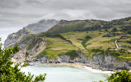 Cantabria landscape with hill, field and abrupt coast of the Atlantic Ocean. Royalty Free Stock Images