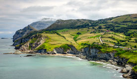 Cantabria landscape with hill, field and abrupt coast of the Atlantic Ocean Stock Photography