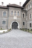 Cantacuzino Castle entrance paved with stone. Cantacuzino Castle from Busteni, Romania is one of great architectural, historical, documentary and artistic value stock photo
