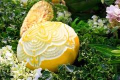 Cantaloup carving Royalty Free Stock Photo
