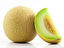 Cantaloup coupé en tranches par vert Photographie stock libre de droits