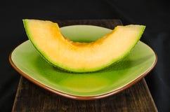 Cantaloup Slice on a plate Stock Photo