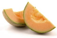 Cantaloupe. Wedges on a white background royalty free stock images