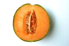 Cantaloupe. Is normally eaten as a fresh fruit, as a salad, or as a dessert with ice-cream or custard. Melon pieces wrapped in prosciutto are a familiar modern Stock Image