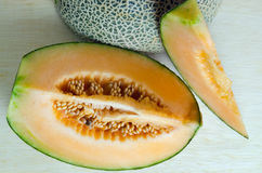 Cantaloupe or Charentais melon with half and seeds on wooden boa Royalty Free Stock Images
