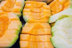 Cantaloupe or Charentais melon sliced background (Other names ar Stock Photo