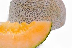 Cantaloupe or Charentais melon sliced on white background Stock Image