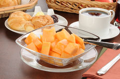 Cantaloupe and croissants Stock Photos