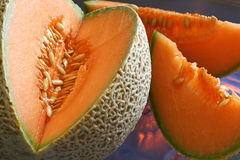 Cantaloupe -- cut with slices. Cut canteloupe with 2 slices or wedges royalty free stock photos