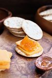 Cantaloupe Jam and Cheddar Cheese Appetizer. Water cracker, cheddar cheese and homemade Salted Vanilla Cantaloupe jam. Extreme shallow depth of field with stock photos