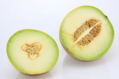 Cantaloupe melon. Cut-ed cantaloupe melon on white background Stock Photography