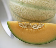 Cantaloupe melon. On black background Royalty Free Stock Images