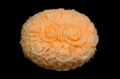 Cantaloupe melon carving display on black background. Cantaloupe melon carving display in Thailand on black background Royalty Free Stock Image