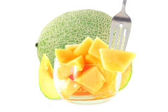 Cantaloupe melon cut and whole in pure white background Royalty Free Stock Image